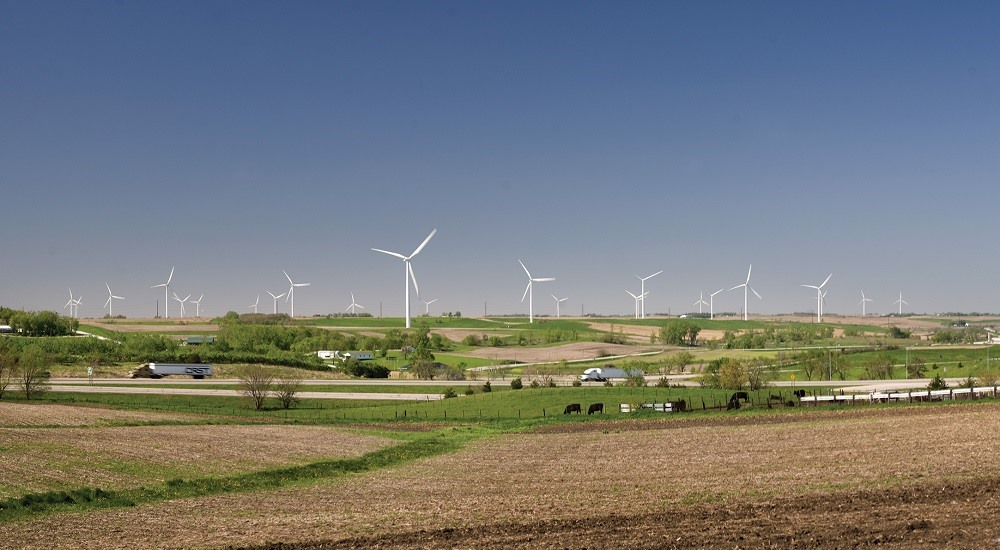 After investing billions in wind, an Iowa electric utility is pledging almost $1B more